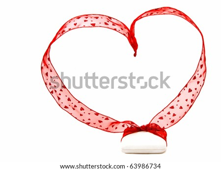 Big love with tiny gift: a small white jewelry box with big red ribbon with hearts and shaped into big heart. Shot on white background. Could be for Christmas, anniversary, Valentine's day... - stock photo