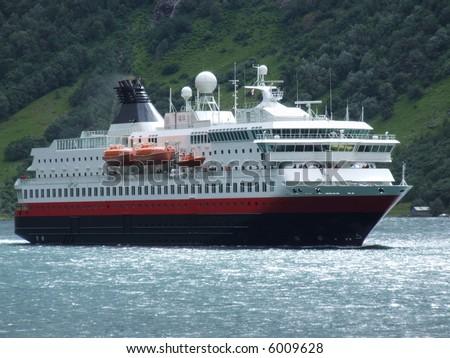 Big, luxurious passenger ferry in a Norwegian Geiranger fjord. - stock photo