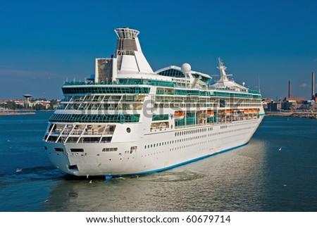 Big luxury cruise ship with Helsinki on Background - stock photo