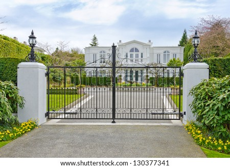 Big luxury custom made house, residence behind the gates in the suburbs of Vancouver, Canada. - stock photo