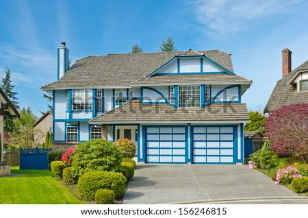 Big luxury double garage doors home, house in the suburbs of Vancouver, Canada.