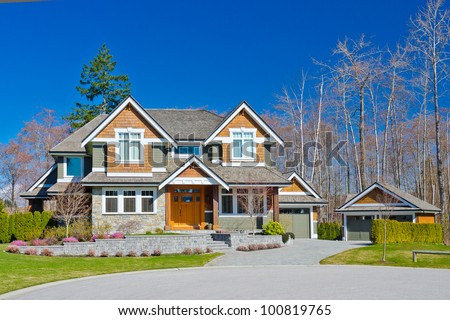 Big luxury  home with detached garage  in the suburbs of North America - stock photo