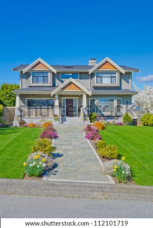 Big luxury  home with nicely paved and flowered doorway in the suburbs of Vancouver, Canada