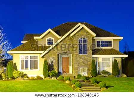 Big luxury house at night ( dawn ) time in suburbs of Vancouver. Canada. - stock photo