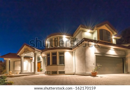 Big luxury house at night, disk, sunset, sunrise time in suburbs of Vancouver, Canada. - stock photo