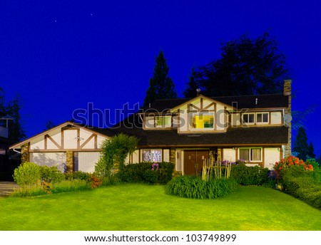 Big luxury house at night time - stock photo