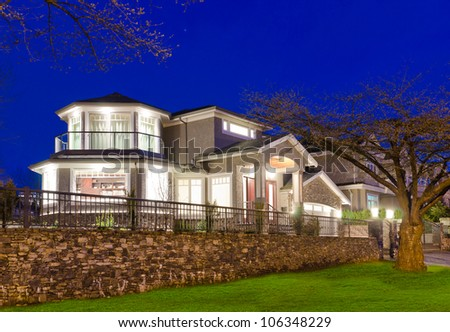 Big luxury house at night time. - stock photo