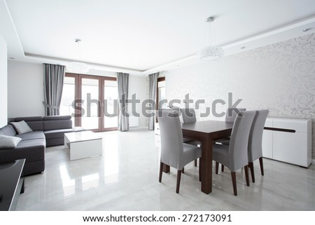 Big luxury living room with wooden square table - stock photo
