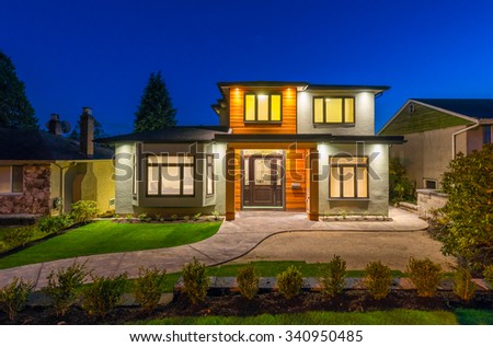 Big luxury, modern house at dusk, night time in suburbs of Vancouver, Canada.