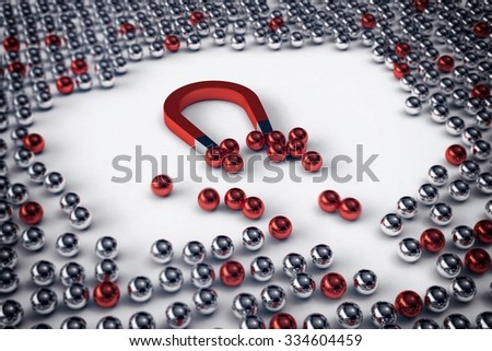 Big magnet attracts only the red balls - stock photo