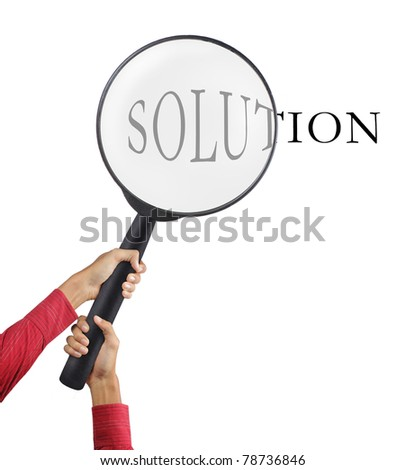 big magnifier glass holded by two hands - stock photo