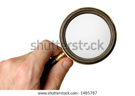 Big magnifying glass in hand isolated on white with clipping path