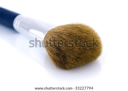 Big make-up brush for face powder or foundation. Isolated on white background, with shadow. - stock photo