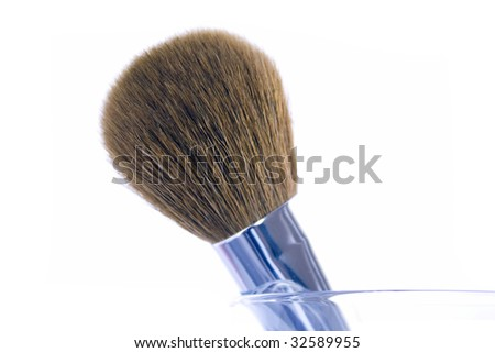 Big make-up brush in a glass. Isolated on white background. - stock photo
