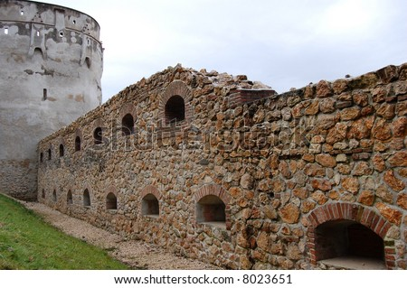 Big medieval stone building wall with windows
