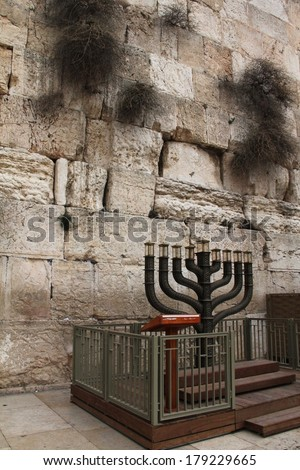 Big menorah on Western Wall background - stock photo