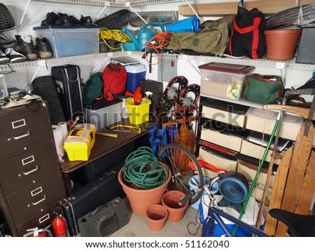 Big mess in an over stuffed suburban garage. - stock photo