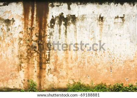 Big messy old worn concrete wall - stock photo