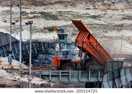 big mining truck unload coal - stock photo