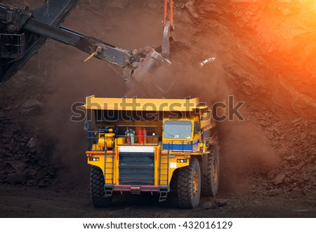 Big mining truck unload coal in coal mining - stock photo