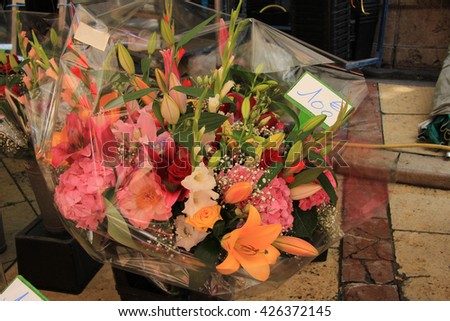 big mixed bouquet at a flower market - stock photo