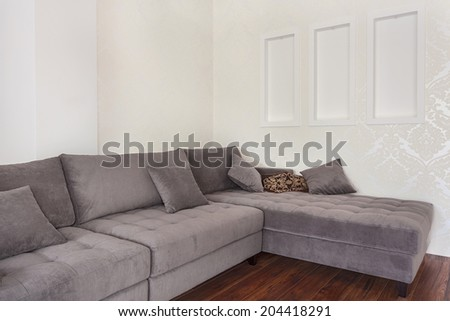 Big modern corner couch in a living room - stock photo