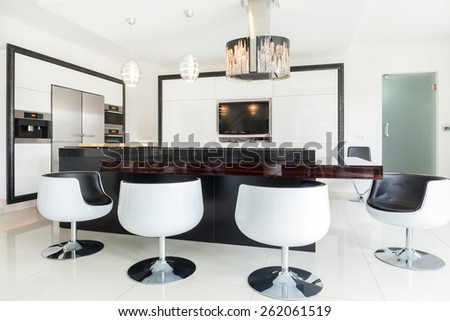 Big modern dining room in luxury residence - stock photo