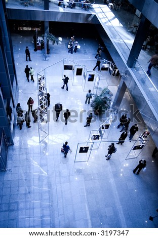 Big modern exhibition hall. Specially with high contrast and blue tint. - stock photo