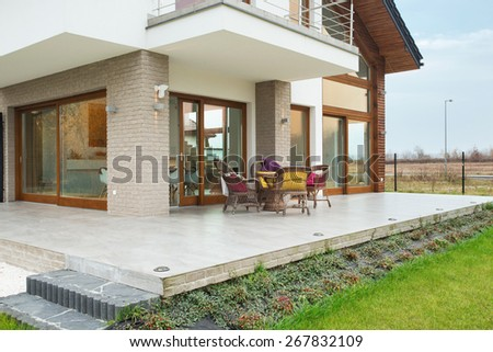 Big modern residence with marble porch - stock photo