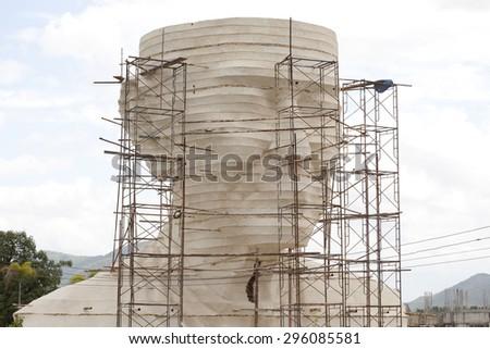 Big monk statue under construction, Thailand. - stock photo