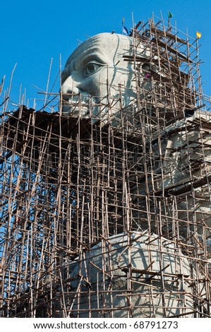 Big monk statue under construction, Thailand.
