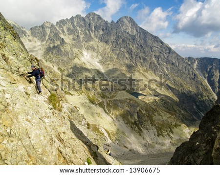 Big mountain, beauty view and climbing man in polish mountain - stock photo