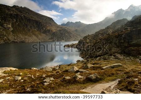 Big mountain lake in Andorra - Jucla. Autumn cloudy day. - stock photo