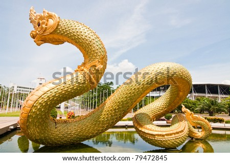 Big Naga statue on the pond, Thailand.