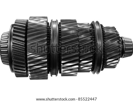 big new automobile gear on isolated background - stock photo