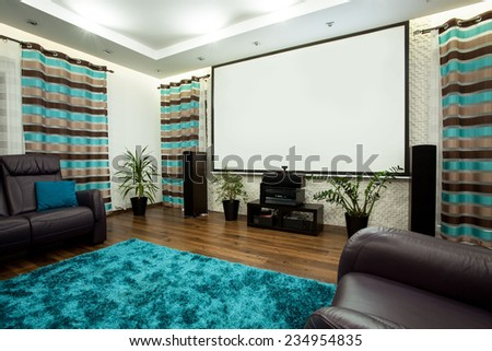 Big new cinema in luxury lounge at home - stock photo
