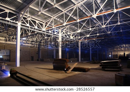 big new hangar with white metal roof - stock photo