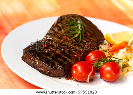 big new york strip steak,grilled,with salad - stock photo