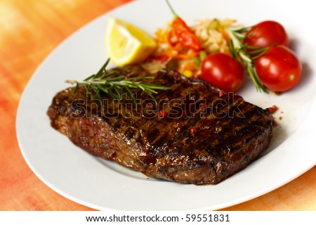 big new york strip steak,grilled,with salad