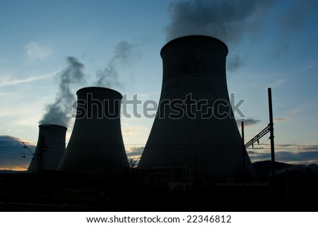 Big nuclear plant smokestack whit sun on the background - stock photo