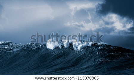 Big ocean wave crashes on the Portuguese coast - Toned black and white - stock photo