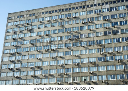 Big office building exterior with plenty conditioners - stock photo