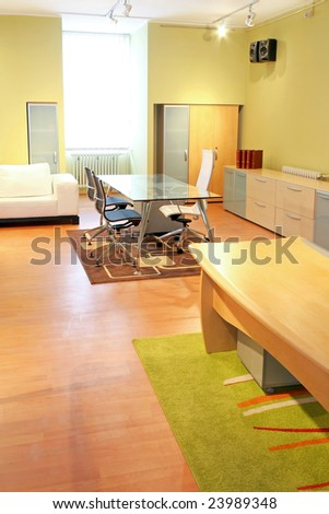 Big office room with glass conference table - stock photo