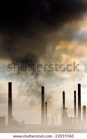 Big oil refinery in a misty morning seeing pollution in the air - stock photo