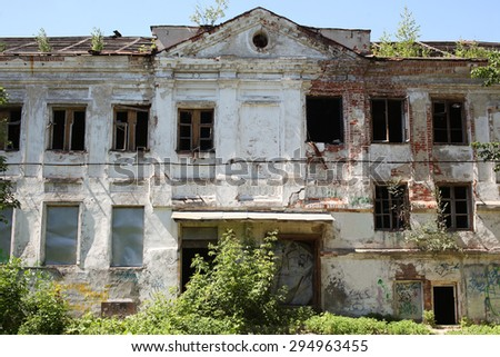 Big old brick burnt abandoned house with windows, general view - stock photo