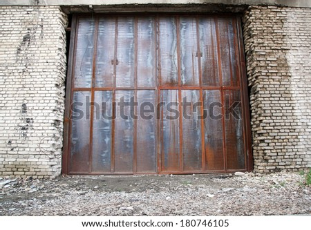 big old garage door - stock photo