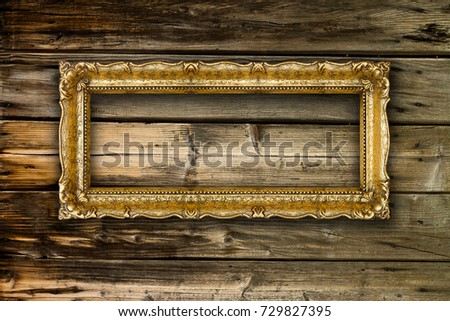 Big Old Gold Picture Frame on wooden background