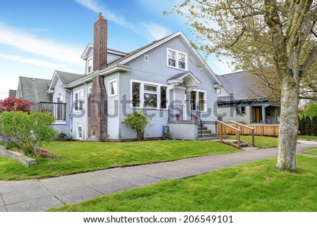 Big old house exterior. View of entrance porch with stairs and walkway - stock photo