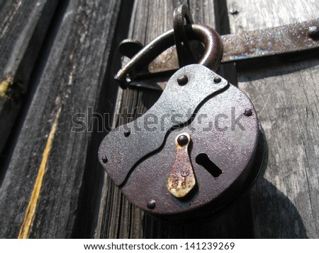 Big old rusty open padlock - stock photo