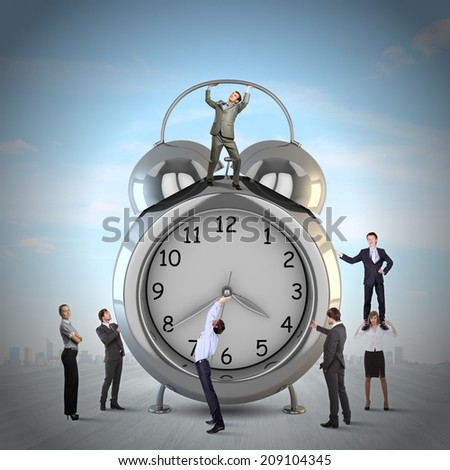Big old-style clock and many businesspeople around - stock photo